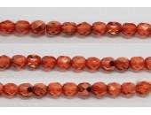 30 perles verre facettes orange fonce demi metalise 8mm