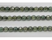 30 perles verre facettes poudre vert 14mm